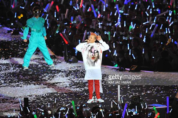 South Korean rapper GDragon performs during the 'Gangnam Style' star Psy's concert 'Happening' in Seoul on April 13 2013 South Korean pop star Psy...