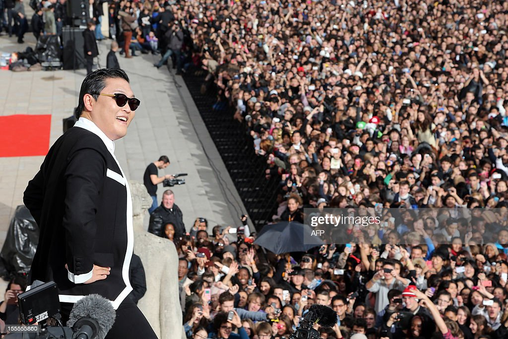 South Korean rapper Park Jae-Sang also known as Psy performs 'Gangnam Style' in front of a crowd during a flashmob on November 5, 2012 in Paris. The video to 'Gangnam Style' went viral after its July release, becoming the second most viewed clip in YouTube history, where it has notched up more than 650 million hits despite being sung almost entirely in Korean.