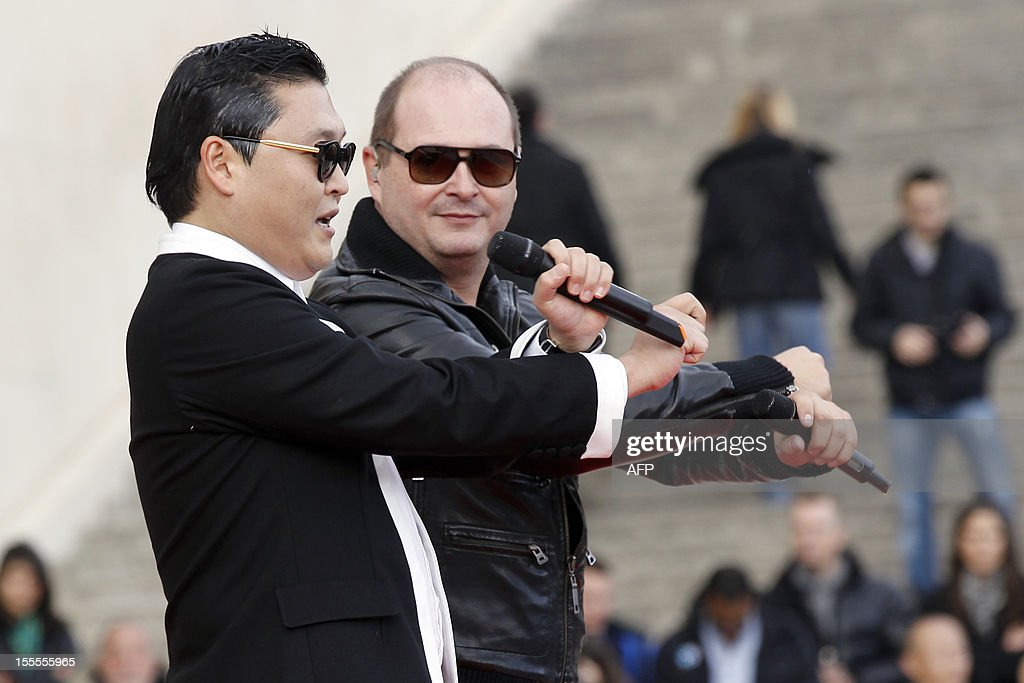 South Korean rapper Park Jae-Sang also known as Psy performs 'Gangnam Style' next to French Tv host Sebastien Cauet in front of a crowd during a flashmob on November 5, 2012 in Paris. The video to 'Gangnam Style' went viral after its July release, becoming the second most viewed clip in YouTube history, where it has notched up more than 650 million hits despite being sung almost entirely in Korean.