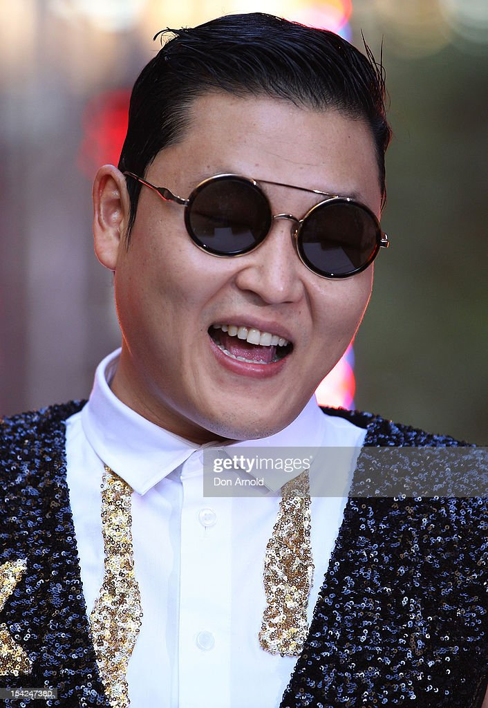 South Korean rapper Psy acknowledges the crowd on Channel 7's 'Sunrise' at Martin Place on October 17, 2012 in Sydney, Australia.