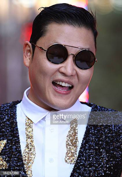 South Korean rapper Psy acknowledges the crowd on Channel 7's 'Sunrise' at Martin Place on October 17 2012 in Sydney Australia