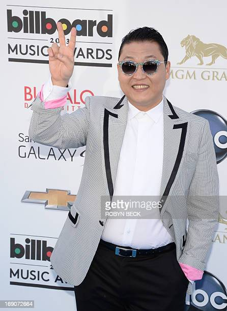 South Korean rapper Psy arrives on the red carpet for the 2013 Billboard Music Awards at the MGM Grand in Las Vegas Nevada May 19 2013 AFP PHOTO /...