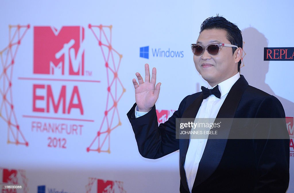 South Korean rapper Psy poses for photographers upon arrival at the 2012 MTV European Music Awards (EMA) at the Festhalle in Frankfurt am Main, central Germany on November 11, 2012.