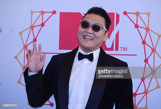 South Korean rapper Psy poses for photographers upon arrival at the 2012 MTV European Music Awards at the Festhalle in Frankfurt am Main central...