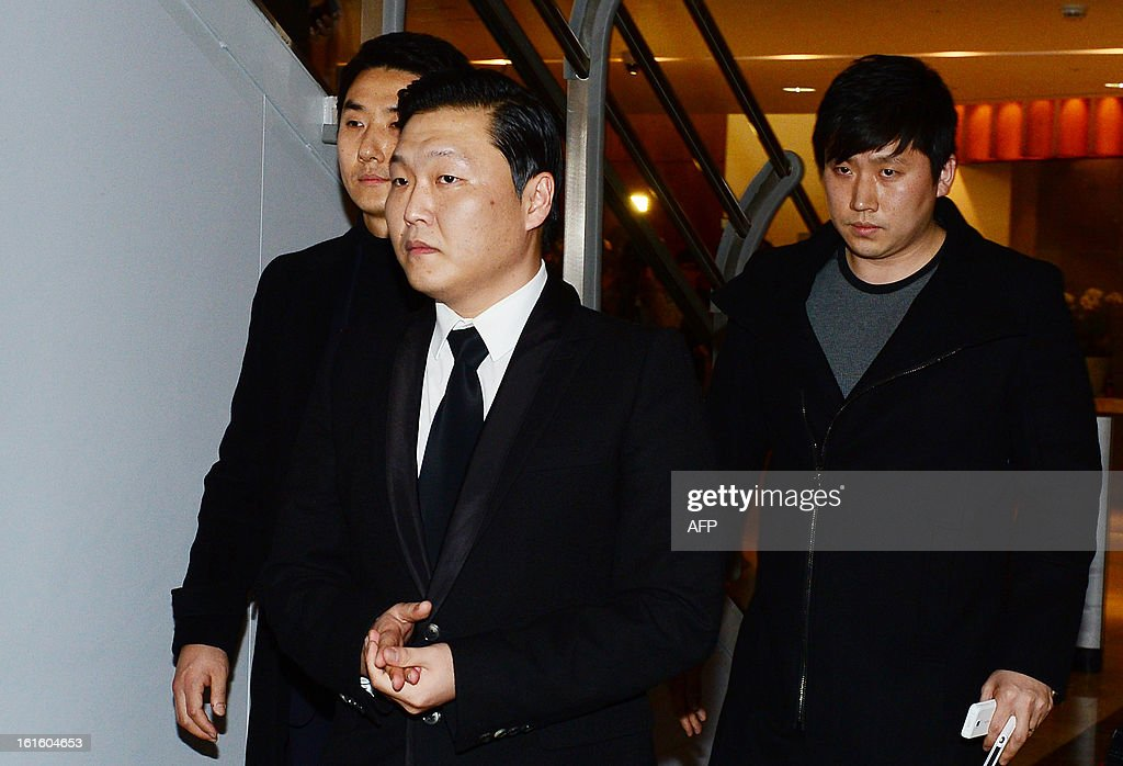 South Korean rapper Psy returns to Korea to pay condolences to members of the Ulala Session and family of Lim Yoon-Taek during a funeral in Seoul on February 12, 2013. Lim, leader of South Korean band Ulala Session died on February 11 from stomach cancer. REPUBLIC OF KOREA OUT JAPAN OUT AFP PHOTO/STARNEWS
