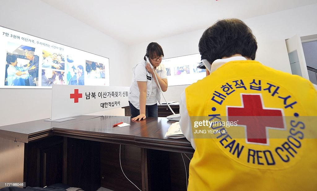 South Korean Red Cross officials talk on the phones as they receive applications for an expected inter-Korean family reunion programme at the Red Cross office in Seoul on August 22, 2013. Red Cross officials from the two Korea will hold talks as planned on August 23 in resuming cross-border family reunions after the North finally agreed to the South's choice of venue.
