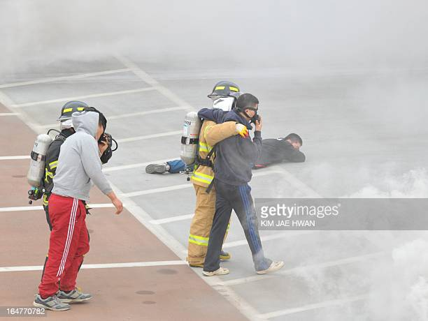 South Korean rescue personnel help 'victims' during a drill near the border with North Korea in Paju on March 28 2013 The US said two nuclearcapable...