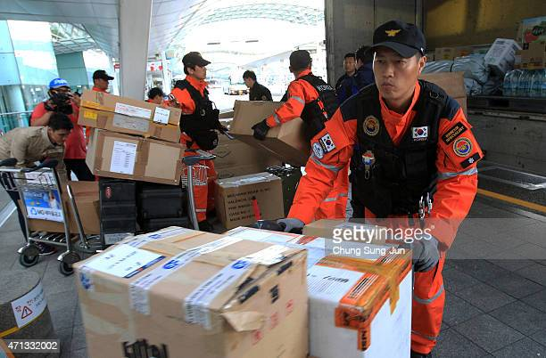 South Korean rescue team members prepare to leave for the quakehit area of Kathmandu at Incheon International Airport on April 27 2015 in Incheon...