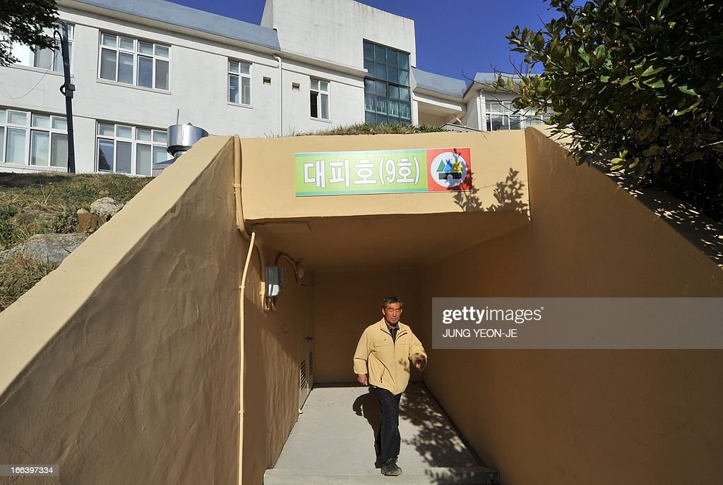 A South Korean resident walks out of an air-raid shelter in a high school at the South Korea-controlled island of Yeonpyeong near the disputed waters of the Yellow Sea on April 12, 2013. South Korea's defence ministry said on April 12 it doubted North Korea had the ability to launch a nuclear-armed ballistic missile as claimed in a report by the US military spy agency.