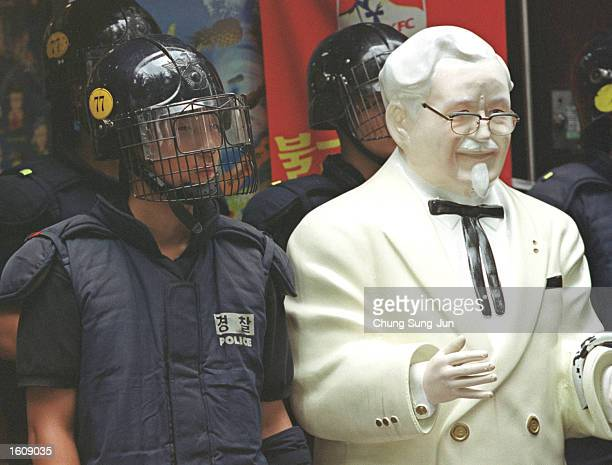 South Korean riot police stand in front of a KFC restaurant during an antiJapan rally near August 14 2001 in Seoul South Korea Demonstrators...