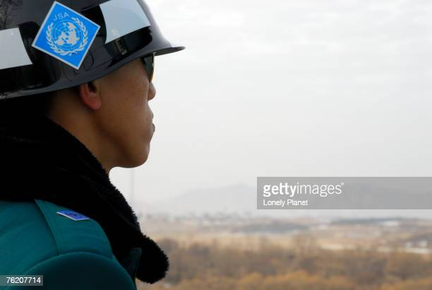 South Korean ROK soldier in Joint Security Area looking to the North across DMZ, Seoul, South Korea, North-East Asia