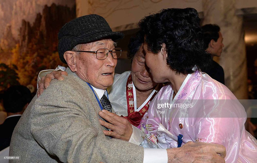 South Korean Ryu Young-Shik (L),92, meets with his North Korean relatives during a family reunion after being separated for 60 years on February 20, 2014 in Mount Kumgang, North Korea. The program, which allows reunions of family members separated by the 1950-53 Korean war, is a result of recent agreement between Koreas which had been suspended since 2010.