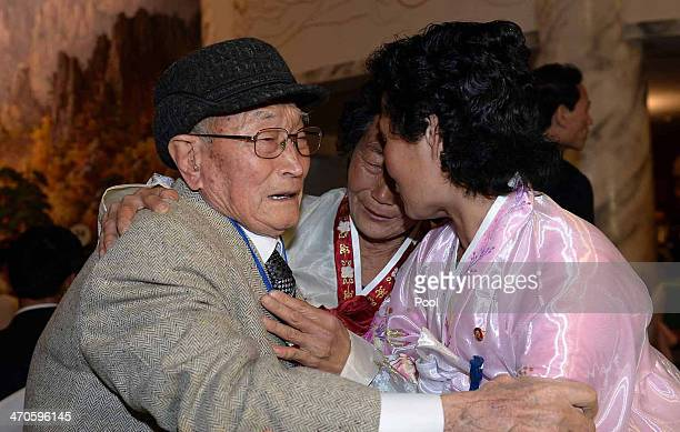 South Korean Ryu YoungShik meets with his North Korean relatives during a family reunion after being separated for 60 years on February 20 2014 in...
