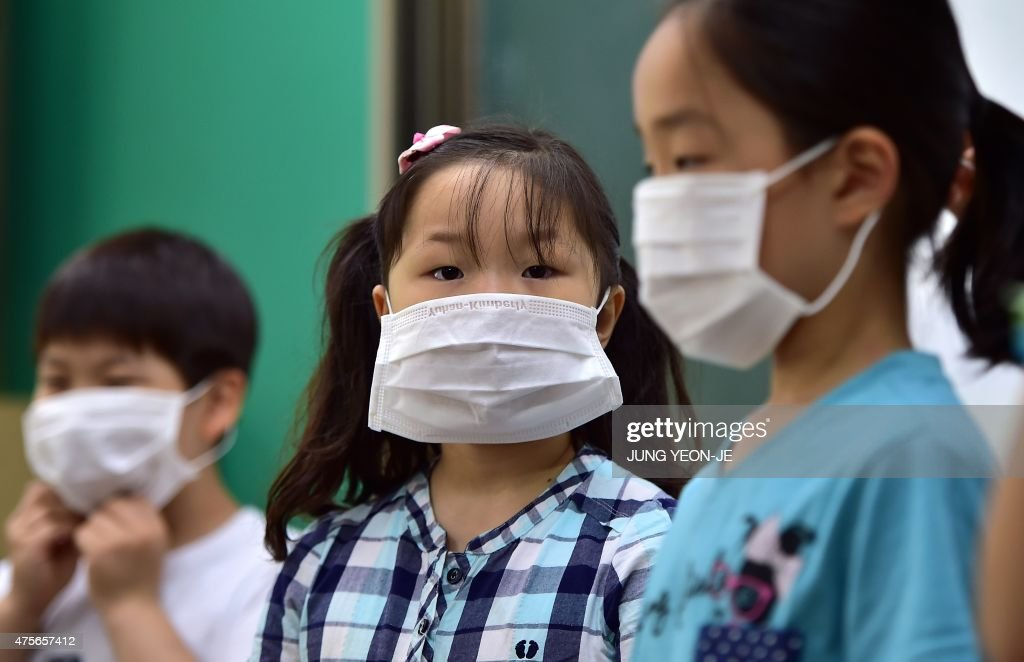 South Korean school students wear face masks during a special class on MERS virus at an elementary school in Seoul on June 3 2015 South Korea on June...