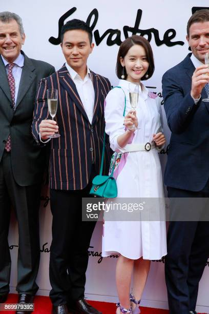 South Korean singer and actress Yoona and actor Julian Cheung attend the reopening ceremony of Salvatore Ferragamo's flagship store on November 3...