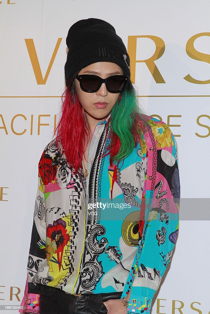 South Korean singer GDragon attends Versace store opening ceremony at Pacific Place on May 19 2013 in Hong Kong Hong Kong