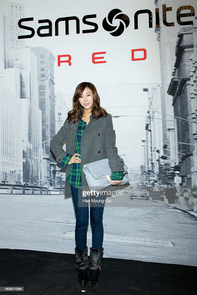 South Korean singer G.NA (bag detail) attends a promotional event for the 'Samsonite RED' Launching on February 7, 2013 in Seoul, South Korea.