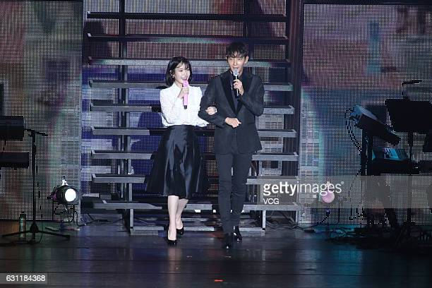 South Korean singer IU performs with South Korean actor and singer Lee Joongi onstage during her concert '24 Steps' on January 7 2017 in Taipei...