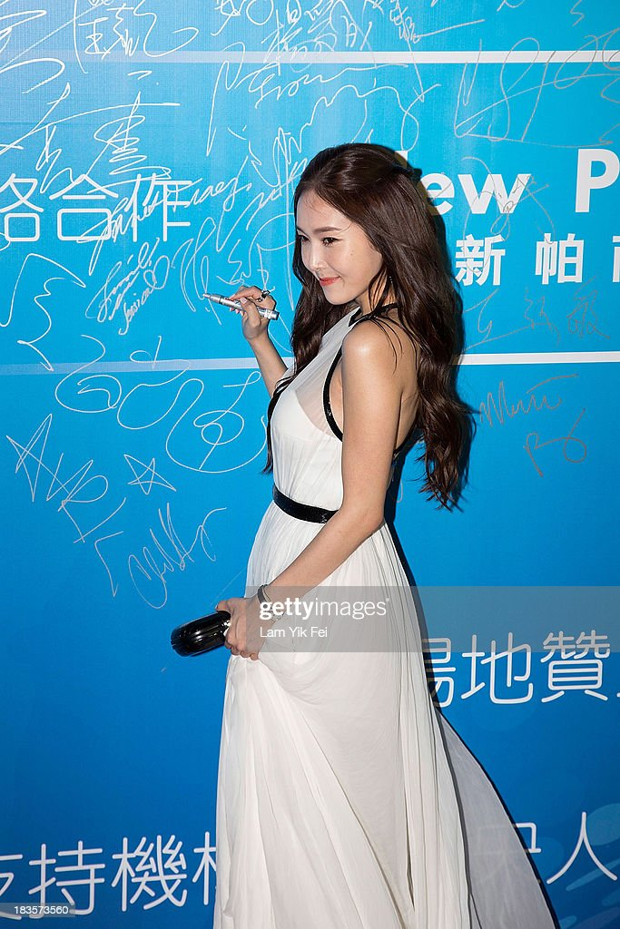 South Korean singer Jessica Jung poses on the red carpet during the 2013 Huading Awards Ceremony at The Venetian on October 7 2013 in Macau Macau