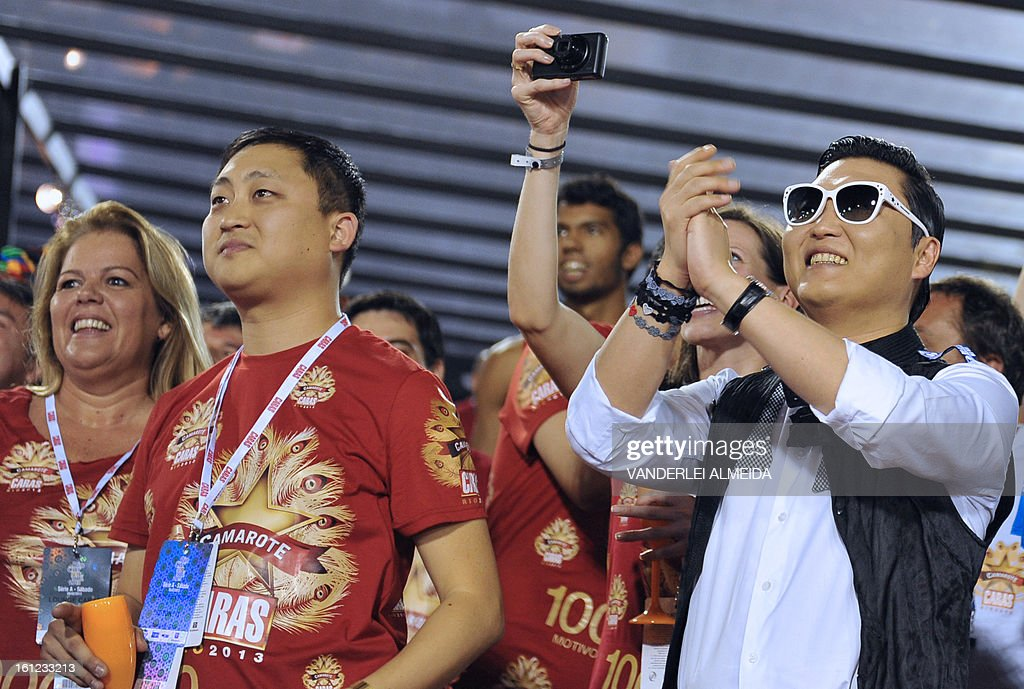 South Korean singer Psy (R) applauds at the Sambadrome in Rio de Janeiro, Brazil on February 9, 2013. The creator of the song 'Gangnam style' is in Rio on a two-day visit to enjoy carnival.
