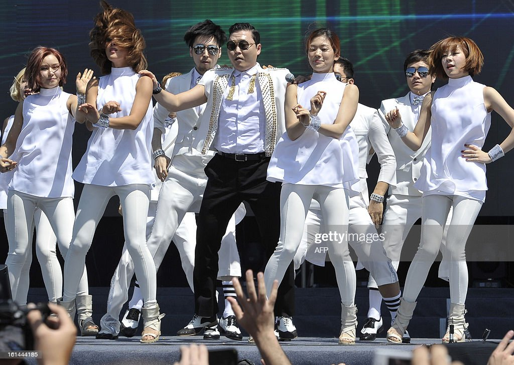South Korean singer Psy (C) dances as he performs his hit single 'Gangnam Style' during a Chinese New Year concert at an event organised by Malaysia's ruling coalition on the northern island of Penang on February 11, 2013. Some 25 percent of Malaysia's 29 million people are ethnic Chinese and celebrate the Lunar New Year.