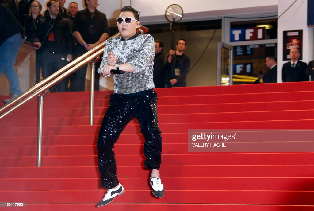 South korean singer Psy dances on the red carpet upon arrival at the Palais des Festivals during the 14th Annual NRJ Music Awards on January 26, 2013 in Cannes, southeastern France. News that the global music industry has finally turned the corner and is on the road to recovery should help get the annual four-day gathering of many of the world's top music execs at the MIDEM trade fair that opens here Saturday off to a good start.