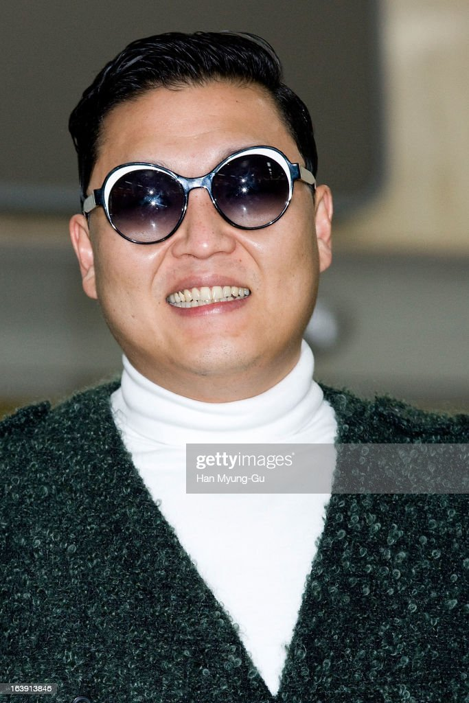 South Korean singer <a gi-track='captionPersonalityLinkClicked' href=/galleries/search?phrase=Psy+-+Intrattenitore&family=editorial&specificpeople=9699998 ng-click='$event.stopPropagation()'>Psy</a> is seen upon arrival at Gimpo International Airport on March 17, 2013 in Seoul, South Korea.