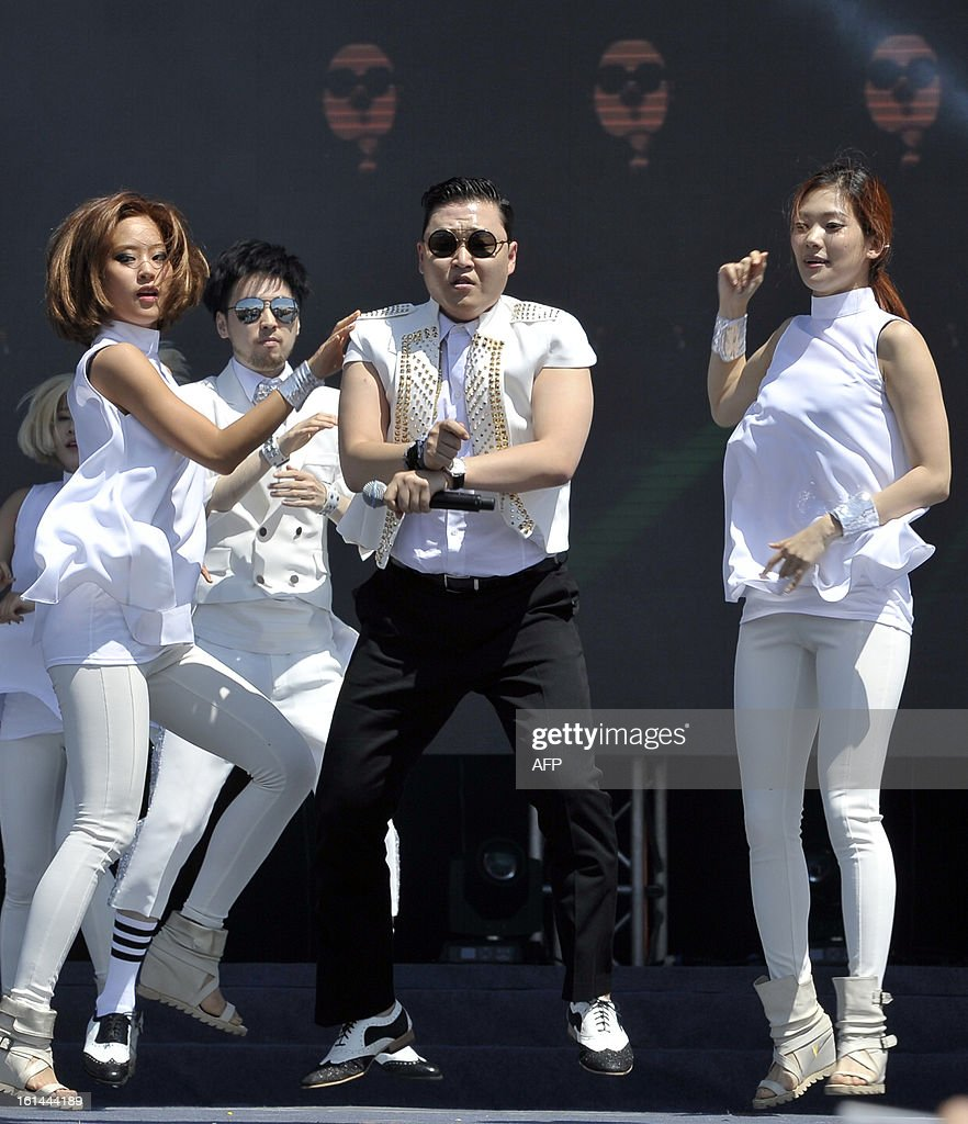 South Korean singer Psy performs his hit single 'Gangnam Style' during a Chinese New Year concert at an event organised by Malaysia's ruling coalition on the northern island of Penang on February 11, 2013. Some 25 percent of Malaysia's 29 million people are ethnic Chinese and celebrate the Lunar New Year. AFP PHOTO --- MALAYSIA OUT