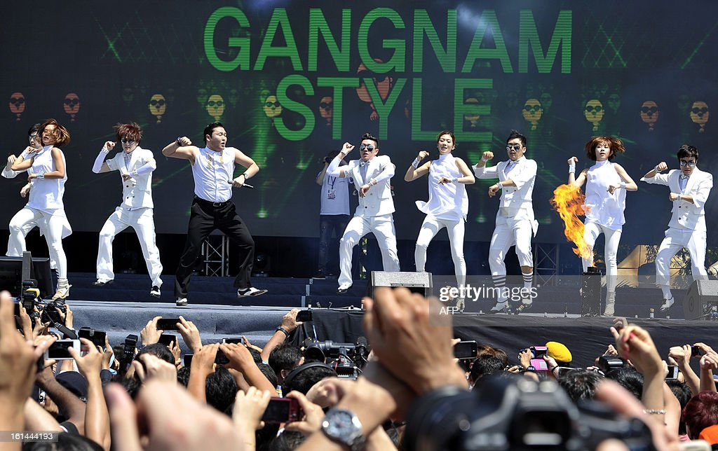 South Korean singer Psy (3rd L) performs his hit single 'Gangnam Style' during a Chinese New Year concert at an event organised by Malaysia's ruling coalition on the northern island of Penang on February 11, 2013. Some 25 percent of Malaysia's 29 million people are ethnic Chinese and celebrate the Lunar New Year.