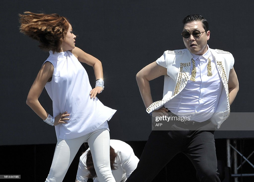 South Korean singer Psy (R) performs his hit single 'Gangnam Style' during a Chinese New Year concert at an event organised by Malaysia's ruling coalition on the northern island of Penang on February 11, 2013. Some 25 percent of Malaysia's 29 million people are ethnic Chinese and celebrate the Lunar New Year.