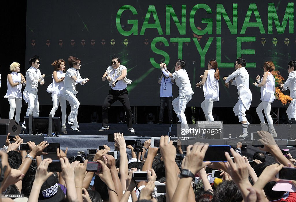South Korean singer Psy (C) performs his hit single 'Gangnam Style' during a Chinese New Year concert at an event organised by Malaysia's ruling coalition on the northern island of Penang on February 11, 2013. Some 25 percent of Malaysia's 29 million people are ethnic Chinese and celebrate the Lunar New Year. AFP PHOTO --- MALAYSIA OUT