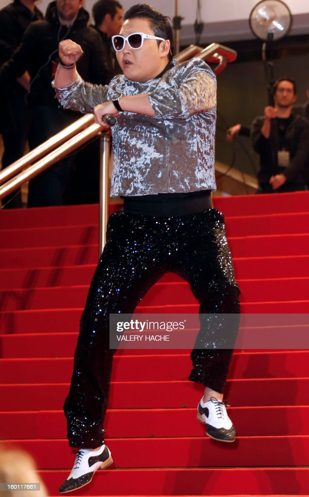 South Korean singer Psy poses upon arrival at the Palais des Festivals during the 14th Annual NRJ Music Awards on January 26, 2013 in Cannes, southeastern France. News that the global music industry has finally turned the corner and is on the road to recovery should help get the annual four-day gathering of many of the world's top music execs at the MIDEM trade fair that opens here Saturday off to a good start.