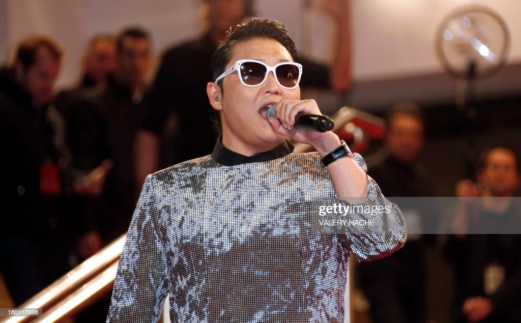 South korean singer Psy sings on the red carpet upon arrival at the Palais des Festivals during the 14th Annual NRJ Music Awards on January 26, 2013 in Cannes, southeastern France. News that the global music industry has finally turned the corner and is on the road to recovery should help get the annual four-day gathering of many of the world's top music execs at the MIDEM trade fair that opens here Saturday off to a good start.