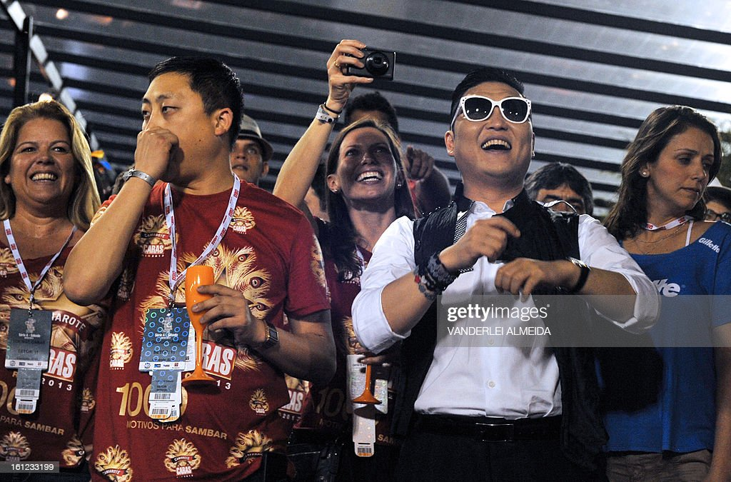 South Korean singer Psy (2-R) smiles at the Sambadrome in Rio de Janeiro, Brazil on February 9, 2013. The creator of the song 'Gangnam style' is in Rio on a two-day visit to enjoy carnival.