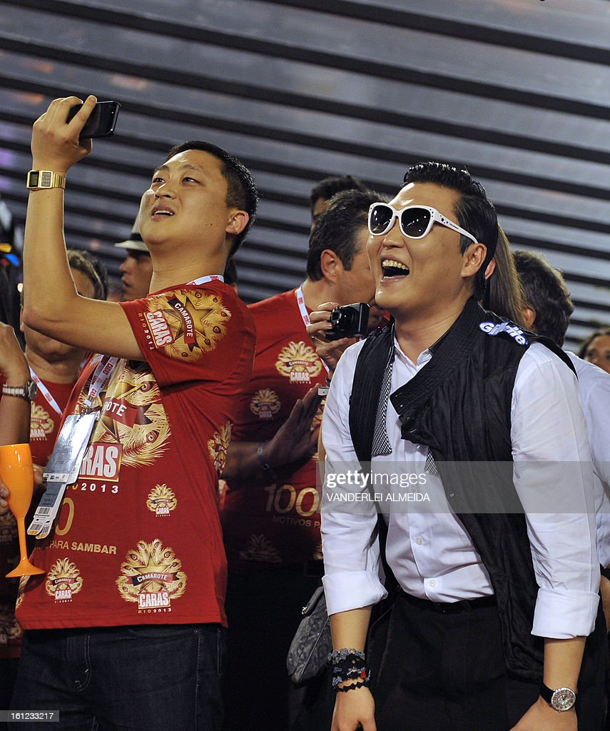 South Korean singer Psy (R) smiles at the Sambadrome in Rio de Janeiro, Brazil on February 9, 2013. The creator of the song 'Gangnam style' is in Rio on a two-day visit to enjoy carnival.