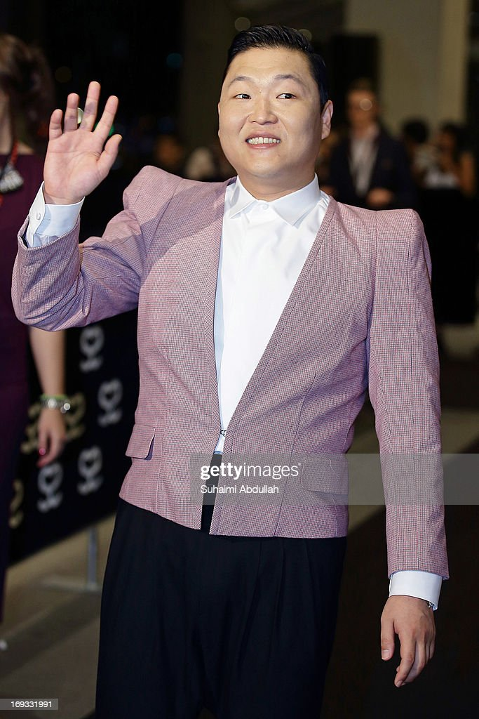 South Korean singer, Psy, waves to the fans on the red carpet during the Social Star Awards 2013 at Marina Bay Sands on May 23, 2013 in Singapore.
