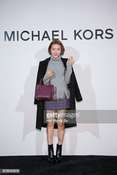 South Korean singer Seo InYoung attends the opening event for 'MICHAEL KORS' Seoul flagship store on December 15 2016 in Seoul South Korea