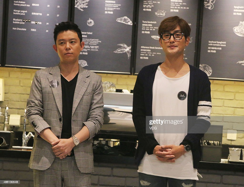 South Korean singer Tony An (L) and friend Kangta attend his store opening ceremony on August 31, 2015 in Shanghai, China.