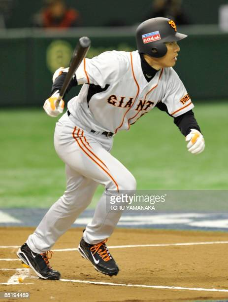 South Korean slugger Lee SeungYoup of Japan's professional baseball team Yomiuri Giants looks at the ball when he hits a tworun double against his...