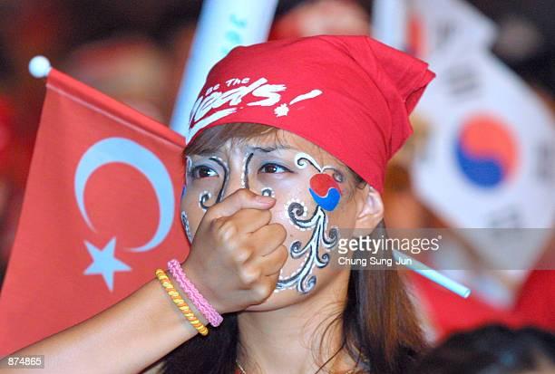 South Korean soccer fan reacts as she watches the 2002 Federation Internationale de Football Association KoreaTurkey World Cup match on a screen June...