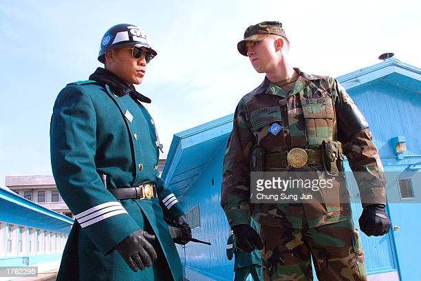 South Korean soldier and a US soldier stand guard February 5 2003 at the truce village of Panmunjom in the Demilitarized Zone between the two Koreas...