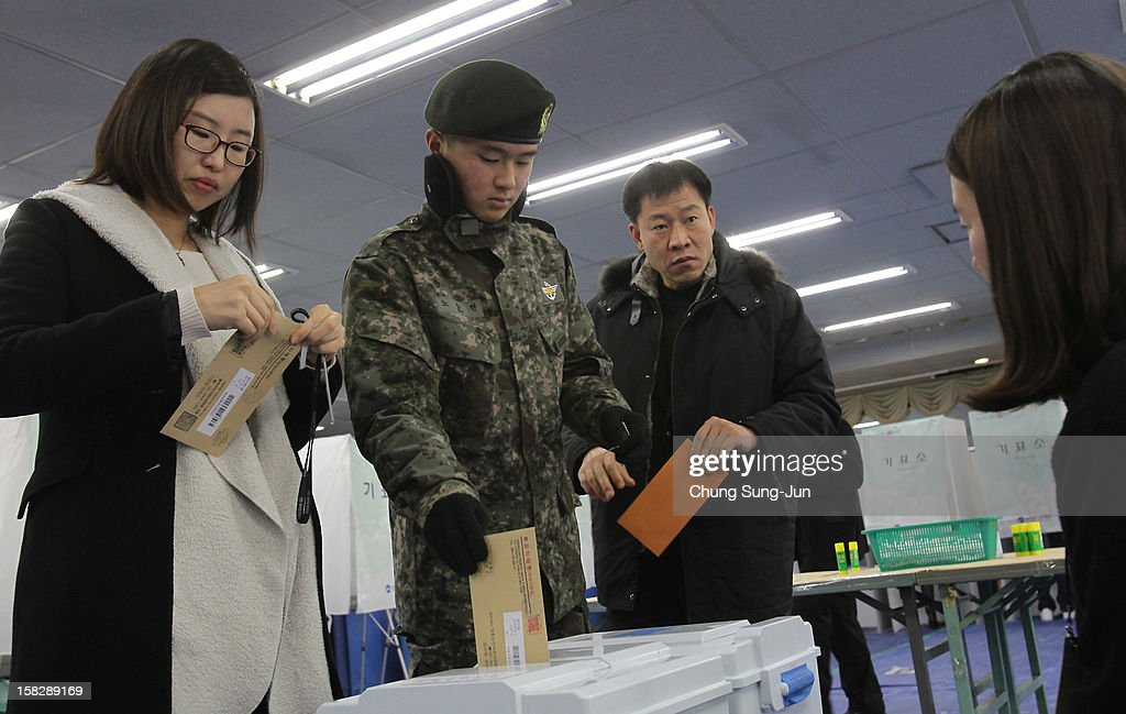 A South Korean soldier casts his absentee ballot for new President in a polling station on December 13, 2012 in Seoul, South Korea. South Koreans vote in the presidential election on December 19.