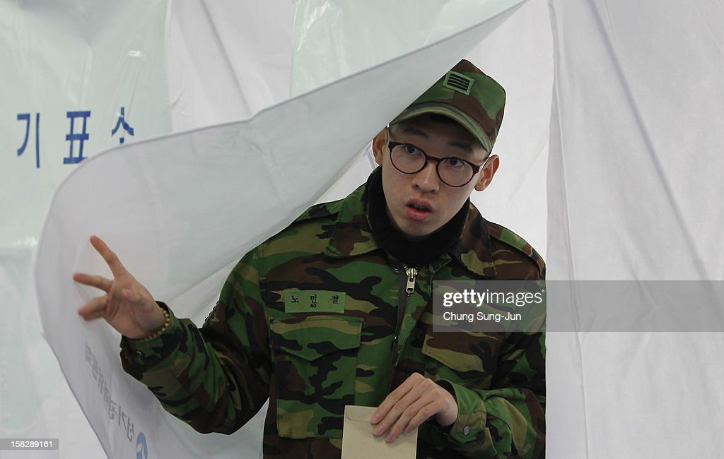 A South Korean soldier exits a booth after casting absentee ballots for new President in a polling station on December 13, 2012 in Seoul, South Korea. South Koreans vote in the presidential election on December 19.