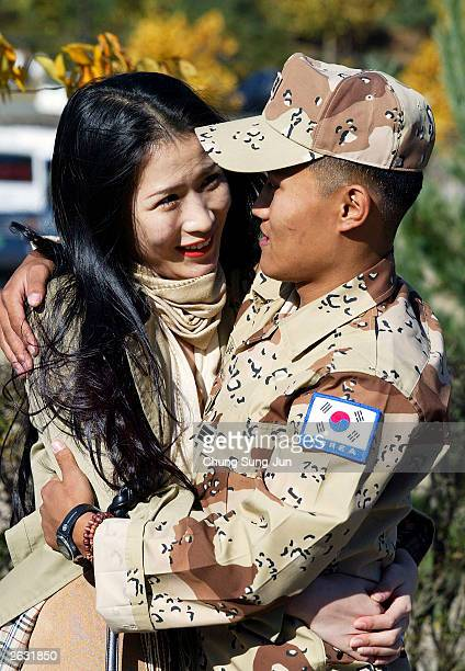 South Korean soldier greets his girlfriend during a welcoming ceremony October 23 2003 at a military base in Gwangju south of Seoul The 323 military...