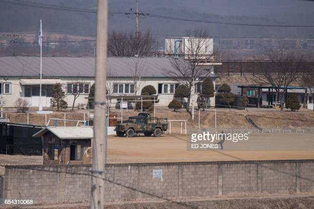 A South Korean soldier kicks a football at his barracks near a checkpoint on the Tongil bridge the entrance to the Panmunjom Joint Security Area near...