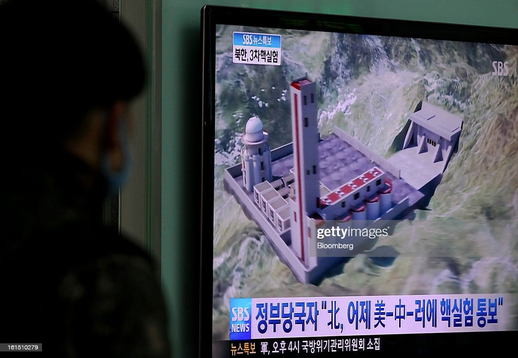 A South Korean soldier looks at a television screen showing a news broadcast illustrating the possible attempt of North Korea's nuclear test at Yongsan Station in Seoul, South Korea, on Tuesday, Feb. 12, 2013. North Korea held its third nuclear test today, underscoring a disregard for an international community that has already isolated the totalitarian state from the global economy. Photographer: SeongJoon Cho/Bloomberg via Getty Images