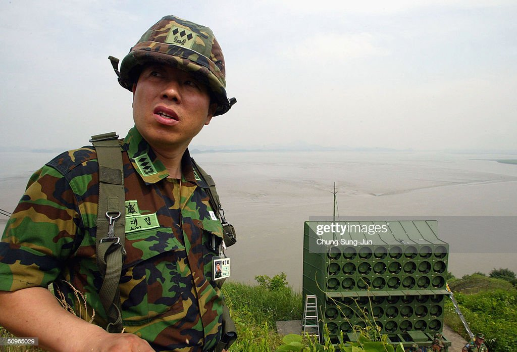South Korean soldier looks on as a battery of propaganda loudspeakers are removed on the border with North Korea on 16 June 2004 in Paju South Korea...