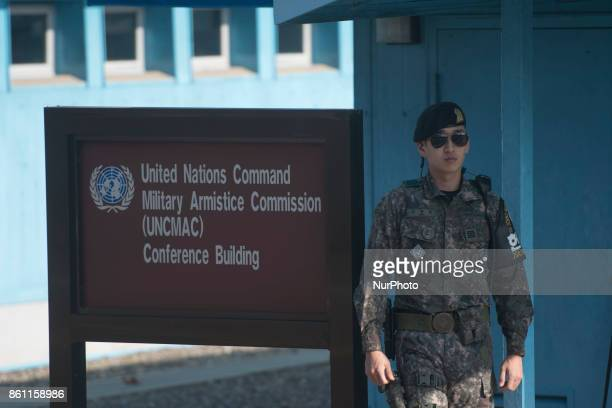 A South Korean soldier patrols in front of the Joint Security Area conference room in the border village of Panmunjom between South and North Korea...