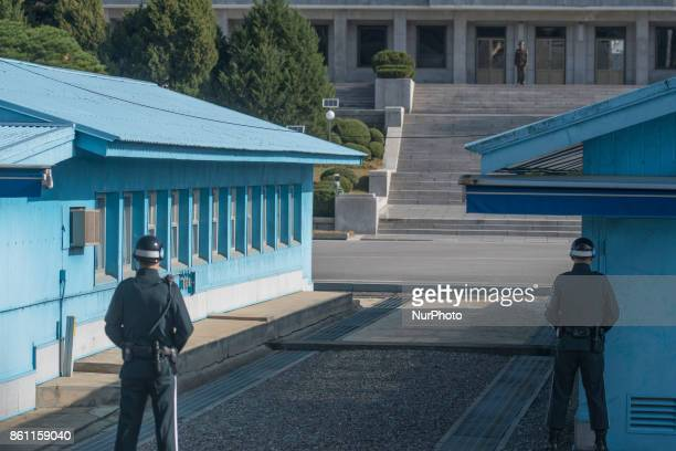 South Korean soldier stand guard facing a North Korean soldier in the border village of Panmunjom between South and North Korea at the Demilitarized...