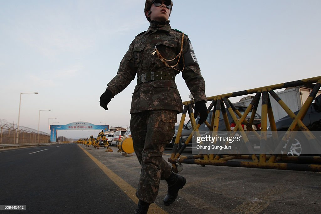 A South Korean soldier stands at a military check point connecting South and North Korea at the Unification Bridge on February 11, 2016 in Paju, South Korea. South Korea announced on February 10, 2016 that the country would close an industrial complex jointly ran with North Korea, as the strongest response for North's recent nuclear test and rocket launch.